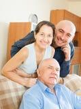 Un ritratto di tre genti sorridenti Fotografia Stock