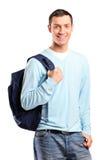 Un ritratto di un allievo maschio con un sacchetto di banco Immagini Stock