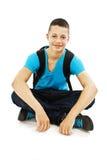 Un ritratto di un allievo maschio con un sacchetto di banco Fotografie Stock