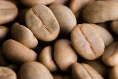 Un-roast arabica raw coffee beans. Close up Stock Image