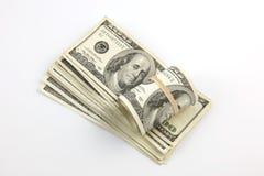Un rodillo y una pila de cientos cuentas de dólar Imagen de archivo
