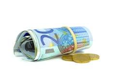 Un rollo de los billetes de banco euro del dinero Fotografía de archivo