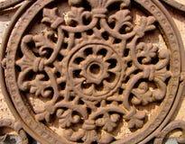 Un rosetón antiguo del metal Imagen de archivo libre de regalías