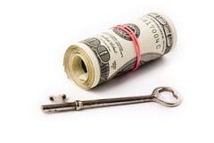 Un rotolo dei dollari e del tasto Fotografie Stock Libere da Diritti