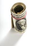 Un rotolo delle fatture o delle banconote di un USD Immagine Stock