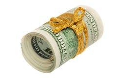 Un rotolo di 100 banconote in dollari Immagini Stock Libere da Diritti