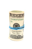 Un rotolo di cento banconote in dollari Fotografie Stock