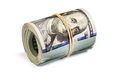 Un rotolo di cento banconote in dollari isolate Fotografia Stock Libera da Diritti