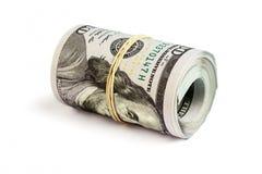 Un rotolo di cento banconote in dollari isolate Fotografie Stock Libere da Diritti