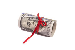 Un rotolo di 100 dollari e dell'arco rosso Fotografie Stock