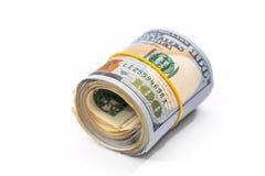 un rotolo di 100 dollari isolato Immagine Stock