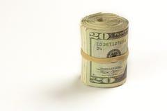 Un rotolo di venti fatture del dollaro Immagine Stock
