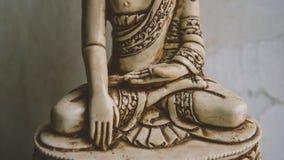 Un símbolo del budismo Figura de Buddha que se sienta Imagen de archivo libre de regalías