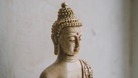 Un símbolo del budismo Figura de Buddha que se sienta Imagen de archivo