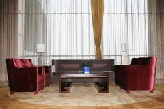 Un salone con il sofà Immagine Stock