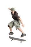 Un salto del skateboarder Fotografia Stock Libera da Diritti
