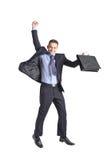 Un salto joven feliz del hombre de negocios Imagen de archivo libre de regalías