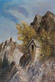 Un santuario di bordo nelle montagne fra due alberi immagini stock libere da diritti