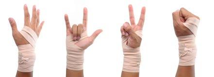 un segno delle 4 mani con la fasciatura elastica fotografie stock