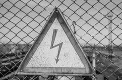 Un segno di alta tensione Fotografie Stock