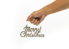 Un segno di Buon Natale dell'argento della tenuta della mano fotografie stock