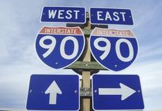 Un segno per 90 da uno stato all'altro orientali ed ad ovest Immagine Stock