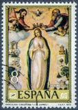 Un sello impreso en España muestra a Inmaculada Concepción de Juan de Juanes Foto de archivo libre de regalías