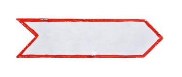 Un signe blanc de flèche peint par métal d'isolement Image libre de droits