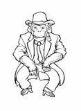 Un singe dans le costume, le lien et le chapeau Photographie stock