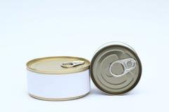Un sistema de comida Tin Can con la etiqueta blanca en blanco en el fondo blanco Fotografía de archivo libre de regalías