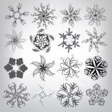 Un sistema de copos de nieve decorativos. Ejemplo del vector Imagen de archivo libre de regalías