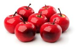 Un sistema de siete manzanas plásticas rojas Imagen de archivo libre de regalías