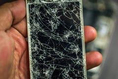 Un smartphone quebrado Fotografía de archivo