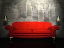 Un sofà rosso ed i due ripari Fotografia Stock