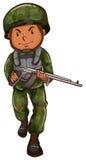 Un soldado valiente que sostiene un arma Imágenes de archivo libres de regalías