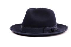 Un sombrero bajo clásico del sombrero de ala de la corona en un color azul marino Imágenes de archivo libres de regalías