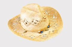 Un sombrero de vaquero de la paja en un fondo gris foto de archivo libre de regalías