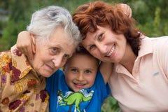 Un sorriso delle tre generazioni Fotografie Stock Libere da Diritti