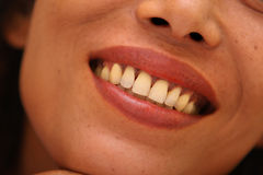 Un sourire de Womans Image libre de droits