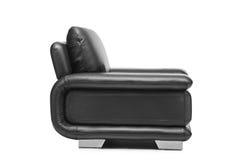 Un studio a tiré d'un fauteuil noir en cuir Images libres de droits