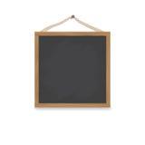 Un tableau en bois carré accroche sur un clou sur une corde Conseil pour un menu ou un dessin Photos libres de droits