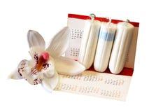 Un tampone igienico femminile su fondo bianco Fotografie Stock Libere da Diritti