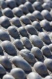 Un tappeto di struttura bianca delle pietre Fotografia Stock