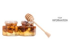 Un tarro de la miel con una cuchara para el modelo de las nueces de la miel Fotos de archivo libres de regalías