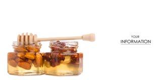 Un tarro de la miel con una cuchara para el modelo de las nueces de la miel Imagen de archivo libre de regalías