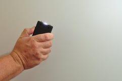 Un taser tenuto in mano Fotografie Stock