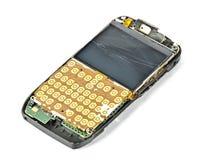 Un teléfono móvil roto abierto imagenes de archivo