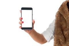 Un telefono nel tenuto in mano da una donna Fotografia Stock Libera da Diritti