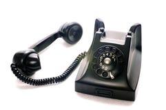 Un telefono nero antico con la maniglia accanto fotografie stock