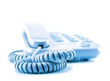 Un telefono in un modo attendente isolato Fotografie Stock Libere da Diritti